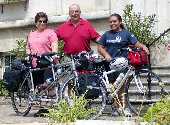 A photo of Jeanette, Jerry and their grand daughter, Roxcie, in the Burgundy region of France during their summer 2004 bike tour.